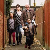 Briana Shann, Hayley Squires, Dave Johns and Dylan McKiernan in 'I, Daniel Blake.' | ©SIXTEEN TYNE LIMITED, WHY NOT PRODUCTIONS, WILD BUNCH, LES FILMS DU FLEUVE, BRITISH BROADCASTING CORPORATION, FRANCE 2 CINEMA AND THE BRITISH FILM INSTITUTE 2016; PORTRAIT PHOTO