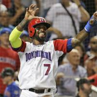 The Dominican Republic's Jose Reyes celebrates after scoring on Jose Bautista's second-inning single against Canada in a first-round game of the World Baseball Classic on Thursday in Miami. | AP