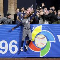 U.S. outfielder Adam Jones made one of the biggest plays of the ongoing World Baseball Classic on Saturday, robbing the Dominican Republic's Manny Machado of a seventh-inning home run at Petco Park in San Diego. | AP