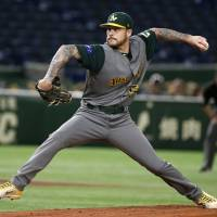 Australia left-hander Travis Blackley pitches against China in the first inning on Thursday. | AP