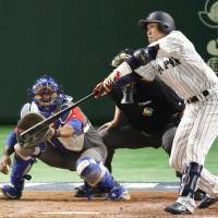 Eighth-inning heroics carry unbeaten Japan past Cuba