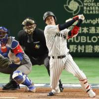 Japan's Tetsuto Yamada delivers a two-run home run off Cuba's Miguel Lahera in the eighth inning of Tuesday's game. Yamada went 3-for-4, scored four times and drove in three runs. | KYODO