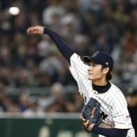 Japan starter Shota Takeda fires a first-inning pitch on Friday night. | AP