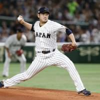 Japan starter Tomoyuki Sugano scattered seven hits and allowed four runs over four innings. | AP