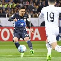 Yuya Kubo scores a second-half goal against Thailand on Tuesday at Saitama Stadium. Japan beat Thailand 4-0 in a World Cup qualifier.   KYODO