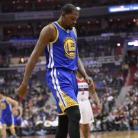 Durant sidelined at least four weeks with knee injury