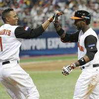 The Netherlands' Jurickson Profar (right) and Xander Bogaerts are among the team's talented crop of young MLB players who burst onto the international scene during the 2013 World Baseball Classic. | AP