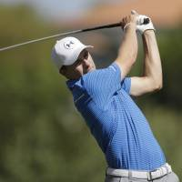 Spieth grinds out victory over Ikeda