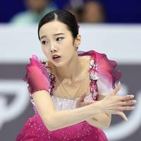 Marin Honda performs her free-skate routine at the World Junior Figure Skating Championships on Saturday. | KYODO