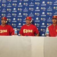 China's Meng Weiqiang (left), Ray Chang (center) and Ju Kwon speak at a World Baseball Classic news conference in Tokyo on Tuesday. | JASON COSKREY