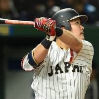 Yoshitomo Tsutsugo hits a solo home run in the sixth inning during Japan's 8-3 win over Israel in the second round of the World Baseball Classic at Tokyo Dome on Wednesday. | AFP-JIJI