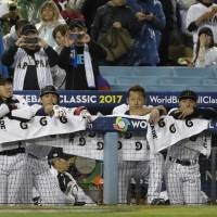 Japan players react to their 2-1 defeat to the United States in the semifinals of the World Baseball Classic on Tuesday at Dodger Stadium in Los Angeles. | AP