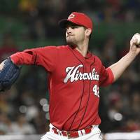 Kris Johnson will try to help the Carp defend the Central League title this season.   KYODO