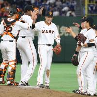 Yomiuri Giants players celebrate the team's 6-2 victory over the Chunichi Dragons at Tokyo Dome on Friday, the opening night of the 2017 NPB season. | KYODO