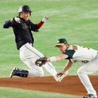 Hayato Sakamoto slides to second base during the fifth inning of Wednesday's game. | KYODO