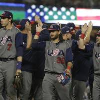 United States celebrates after defeating Japan, 2-1, in a semifinal in the World Baseball Classic in Los Angeles on Tuesday. | AP