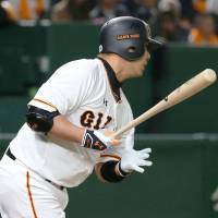 Giants star Shinnosuke Abe hits an RBI single in the third inning. He also belted a two-run homer in the first. | KYODO