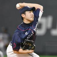 Lions lefty Yusei Kikuchi pitches against the Fighters on Friday at Sapporo Dome. Kikuchi worked seven innings in Seibu's 8-1 season-opening victory over Hokkaido Nippon Ham. | KYODO