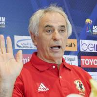 Vahid Halilhodzic gestures at a press conference on Wednesday ahead of Japan's game against the United Arab Emirates in Al Ain. | KYODO