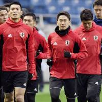 Shinji Kagawa (center) started Japan's World Cup qualifier against the United Arab Emirates last Thursday but is unsure if he will play against Thailand on Tuesday. | KYODO