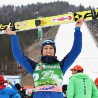 Noriaki Kasaki celebrates after finishing third in a ski jumping World Cup event in Planica, Slovenia, on Sunday. | KYODO