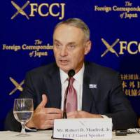 MLB commissioner Rob Manfred speaks at the Foreign Correspondents' Club of Japan on Tuesday. | KAZ NAGATSUKA