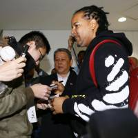 Former major league slugger Manny Ramirez signs autographs for fans after arriving at Narita airport on Tuesday to play for the Kochi Fighting Dogs in the Shikoku Island League Plus. | KYODO