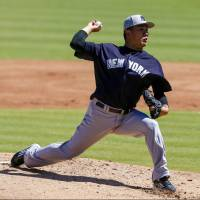 Tanaka, relievers no-hit Tigers at spring training