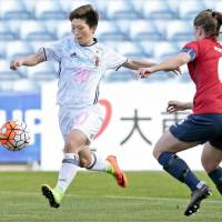 Japan's Kumi Yokoyama controls the ball as Norway's Maren Mjelde defends during Monday's Algarve Cup match in Faro, Portugal.   GETTY / KYODO