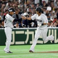 Sho Nakata, seen rounding the bases on Friday night against China, slugged home runs in each of Japan's last two first-round games at Tokyo Dome during the ongoing World Baseball Classic. | AFP-JIJI