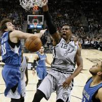 Spurs overcome fatigue to defeat T-Wolves