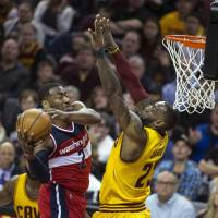 Speed demon Wall leads Wizards past Cavaliers