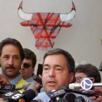 Former Chicago Bulls general manager Jerry Krause, seen in an October 1995 file photo, served as the architect of the team's six NBA championships in eight seasons. He died on March 21 at 77. | AP