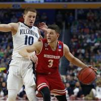 Wisconsin's Zak Showalter dribbles against Villanova's Donte DiVincenzo on Saturday. | USA TODAY / VIA REUTERS
