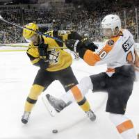 Flyers prevail to keep faint playoff hopes alive
