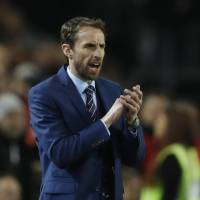England manager Gareth Southgate guides the national team against Lithuania on Sunday. | REUTERS
