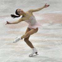 Marin Honda competes during the short program at the world junior championships in Taipei on Friday night. Honda was in second place heading into Saturday's free skate. | AFP-JIJI