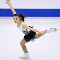 Kaori Sakamoto skates during the short program at the world junior championships in Taipei on Friday night. Sakamoto was in third place ahead of Saturday's free skate. | KYODO