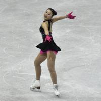 Yuna Shiraiwa performs during the short program at the world junior championships in Taipei on Friday night. Shiraiwa was fifth going into Saturday's free skate. | AFP-JIJI
