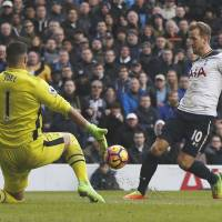 Kane hits double as Tottenham keeps faint title hopes alive