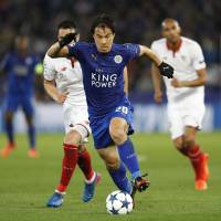 Leicester City's Shinji Okazaki runs with the ball during Tuesday's Champions League game against Sevilla. | REUTERS