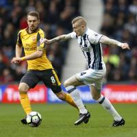West Brom's James McClean (right) takes on Arsenal's Aaron Ramsey at The Hawthorns on Saturday. | REUTERS