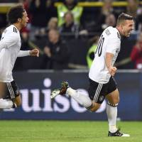 Germany's Podolski produces storybook finish with lone goal in final match of international career