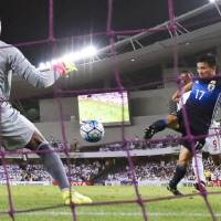 Yasuyuki Konno scores Japan's second goal in its 2-0 victory over the United Arab Emirates in Al Ain on Thursday night. | KYODO