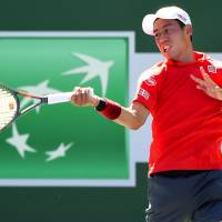 Kei Nishikori plays a shot during his second-round win over Daniel Evans at the BNP Paribas Open on Sunday. | KYODO
