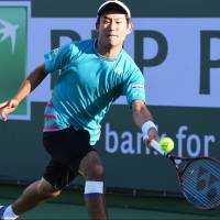 Yoshihito Nishioka plays a shot against Tomas Berdych in their third-round match at the BNP Paribas Open on Monday in Indian Wells, California. | USA TODAY / VIA REUTERS