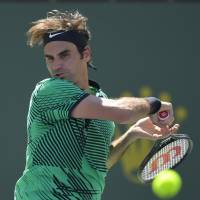 Roger Federer plays a shot during his semifinal win over Jack Sock at the BNP Paribas Open on Saturday. | AP