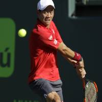 Kei Nishikori plays a shot from Italy's Fabio Fognini in their quarterfinal match at the Miami Open on Wednesday. Fognini won 6-4, 6-2. | AP