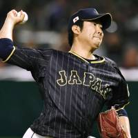 Japan starter Tomoyuki Sugano pitches against a Taiwanese all-star team during an exhibition game on Wednesday in Fukuoka. | KYODO