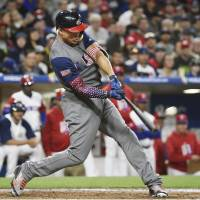 Giancarlo Stanton hits a two-run home run in the fourth inning of the United States' 6-3 win over the Dominican Republic in San Diego on Saturday. | KYODO
